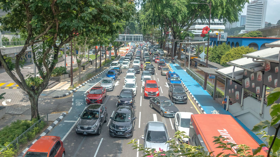 Traffic jam during festive seasons in Kuala Lumpur One Way Queue Architecture Car City Connection Day High Angle View Incidental People Land Vehicle Mode Of Transportation Motion Motor Vehicle Outdoors Road Street Traffic Traffic Jam Transportation Tree