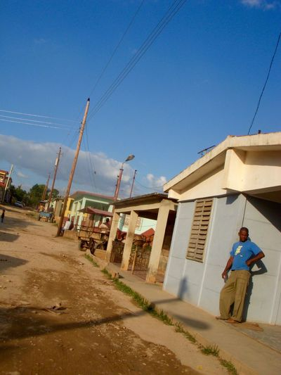 Architecture Building Exterior Built Structure Cuba Cuba Collection Cuban Cuban Cars Cuban Life Cuban Lifestyle Cuban Style Day Full Length Low Angle View Men One Person Outdoors People Real People Sky