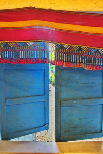Multi Colored Blue Architecture No People Day Built Structure Outdoors Close-up Blue Window Window Window With Colorful Cloth Window Frame Window Pane Old Window Wooden Window Window With Cloth