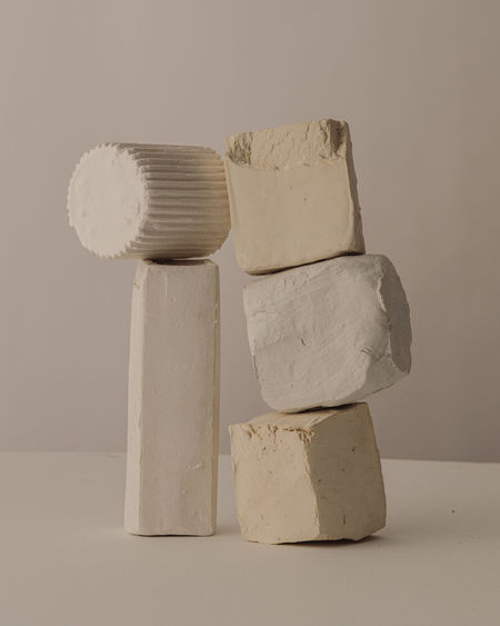 Close-up of stack on table against white background