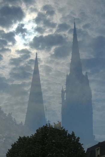 Chartres Cathedral Reflection.... EyEmNewHere Reflection Glass Reflection Cloudy Cloud - Sky City Cityscape Tree Sunset Place Of Worship History Religion Urban Skyline Skyscraper High Section Tall - High