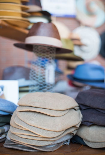 Close-Up Of Flat Caps In Store For Sale