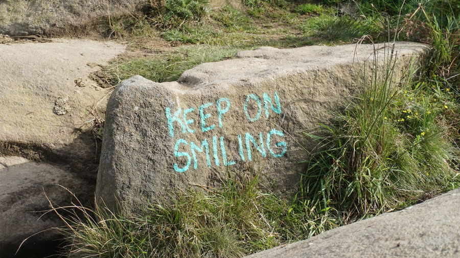 Communication Day Dirt Road Footpath Green Color Keep On Smiling! No People Outdoors Plant Stone Stone Material Text Weathered Western Script Written Be. Ready.