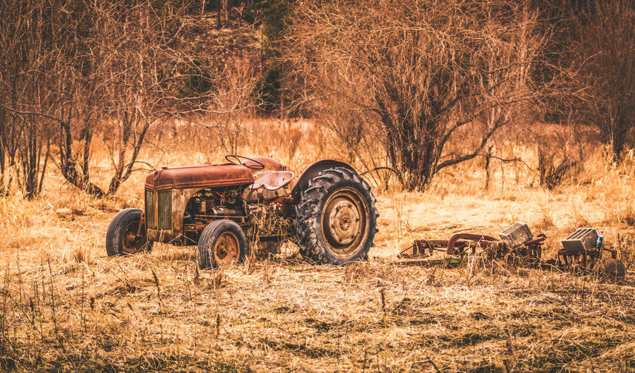 Abandoned tractor on field