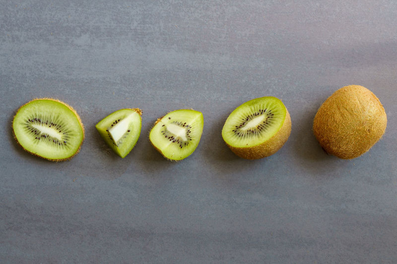 Line of Kiwi Abundance Arrangement Close-up Eyeem Closeup Food Freshness Fruit Green Green Color Group Of Objects Healthy Eating Kiwi Kiwi Fruit LINE Medium Group Of Objects No People Organic Overhead View Pieces Ripe Side By Side Still Life Studio Shot Variation
