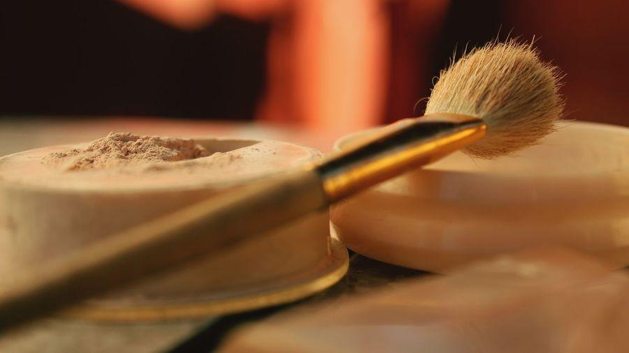 Close-Up Of Make-Up Brush And Powder