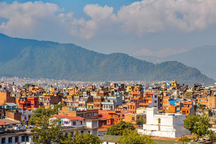 Kathmandu Nepal Apartment Architecture Building Building Exterior City Cityscape Cloud - Sky Crowded Day High Angle View House Mountain Mountain Range Nature No People Outdoors Residential District Settlement Sky Town TOWNSCAPE Urban Skyline