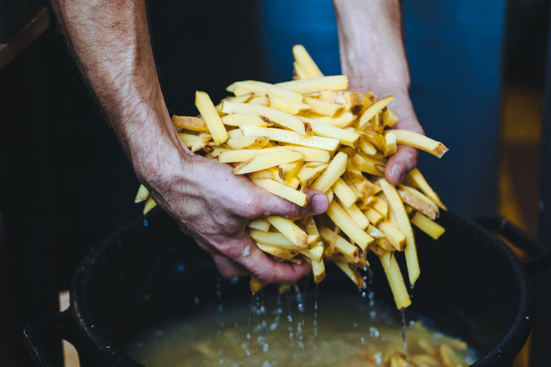 making fresh french fries Day Fast Food Food Food And Drink French Fries Freshness Hands Potato Prepared Potato Streetfood Vegetable Yellow