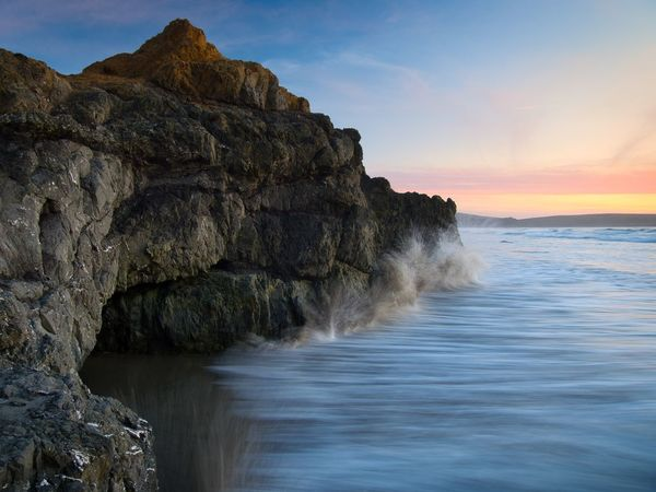 Long exposure waves rushing into sea cave at Dillon Beach. Sea Beach Motion Water Sunset Sky Outdoors Rock Cave Flowing Water Beauty In Nature Solid Water In Motion Crashing Waves  Horizon Over Water Rock - Object Dillon Beach, CA Scenics - Nature Tomales Bay Bodega Bay Sonoma Coast Rock Formation Power In Nature