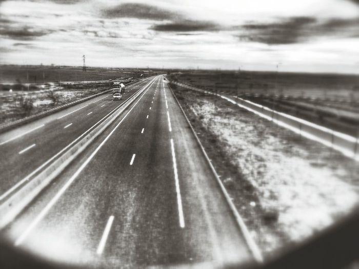 Road passing through dramatic sky