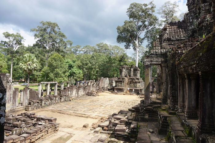 Ancient Ancient Civilization Angkor Archaeology Architectural Column Architecture Bad Condition Built Structure Damaged Day History Nature No People Old Ruin Outdoors Sky Temples Temples And Shrines The Past Tourism Travel Travel Destinations Tree