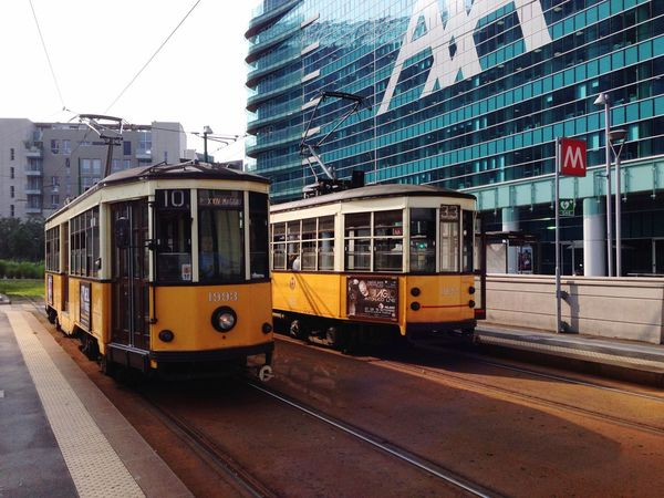 Transportation City Building Exterior Public Transportation Built Structure Travel Architecture Mode Of Transport City Street Outdoors Train - Vehicle Railroad Track City Life Cable Car Yellow Travel Destinations Speed Tram Sky No People Adapted To The City