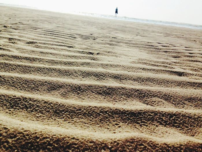 Perspectives On Nature Sand Beach Sand Dune Outdoors Wave Shape One Person Anotherperspective First Eyeem Photo EyeEmNewHere The Week On EyeEm Laying On The Ground Sandy