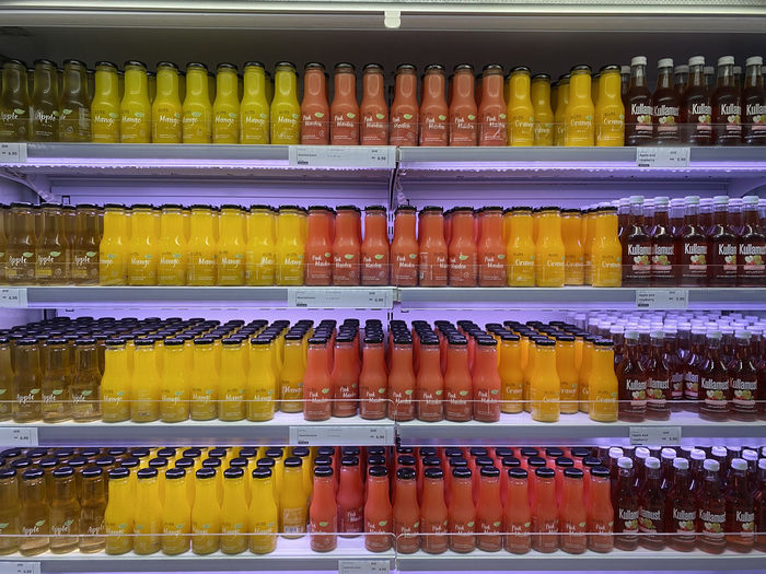 Full frame shot of multi colored bottles in shelf