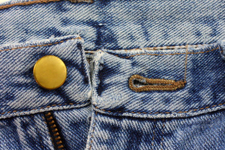 Jeans buttons close up Blue Button Casual Clothing Close-up Clothing Clothing; Garment; Fabric; Folded; Texture; Color; Skin; Background; Zipper; Isolated; White; Denim; Jean; Fashion; Close-up; Threadbare; Modern; Up; Cotton; Close; Blue; Pattern; Button Day Jeans No People Textile Textured