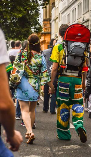 Tourists Walking In Street