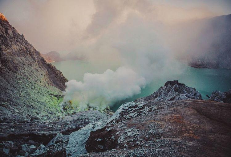 Smoke Emitting From Ijen Volcano By Lake
