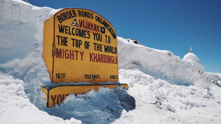 Khardung La Pass, Highest pass of the world India View Point Cold Temperature Highest Mountain Himalayas Top Of The Mountains Leh Ladakh India Khardungla Snow Cold Temperature Winter Text Nature Communication Sign Snowcapped Mountain