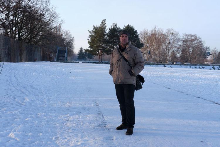 Portrait of man standing on snow field