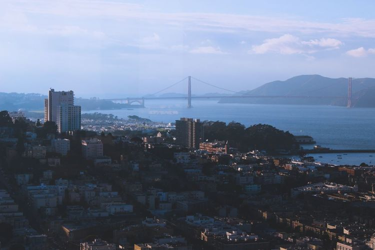Cityscape by san francisco bay with golden gate bridge in background