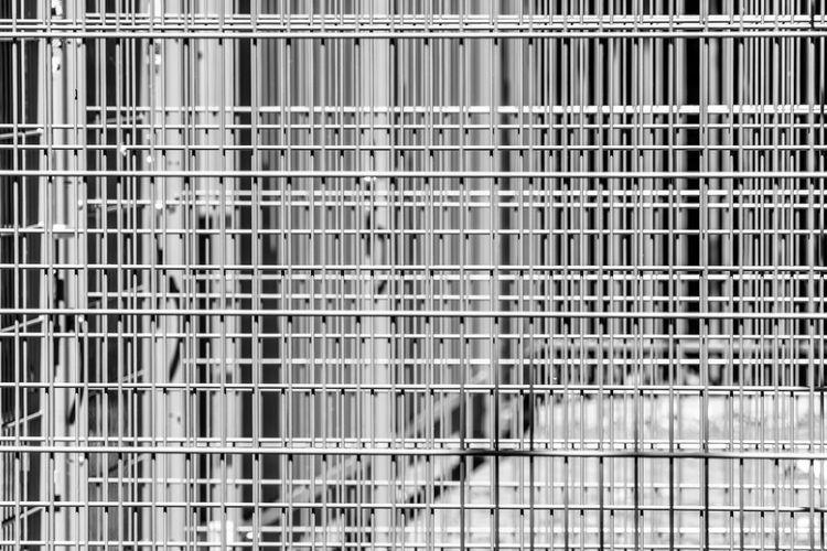 Abstract austere geometric pattern of iron bars, several barriers in front of a stadium Alloy Architecture Backgrounds Building Close-up Day Full Frame Grate Grid In A Row Indoors  Metal Metal Grate No People Pattern Repetition Safety Security Shelf Square Shape Steel