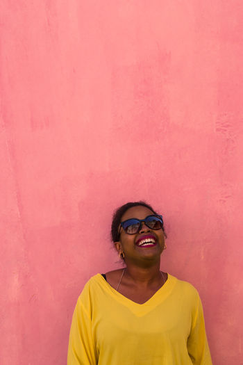 Yellow One Person Adult Adults Only Sunglasses Pink Color Smiling Portrait Happiness Front View Standing Cheerful Lifestyles Paint The Town Yellow
