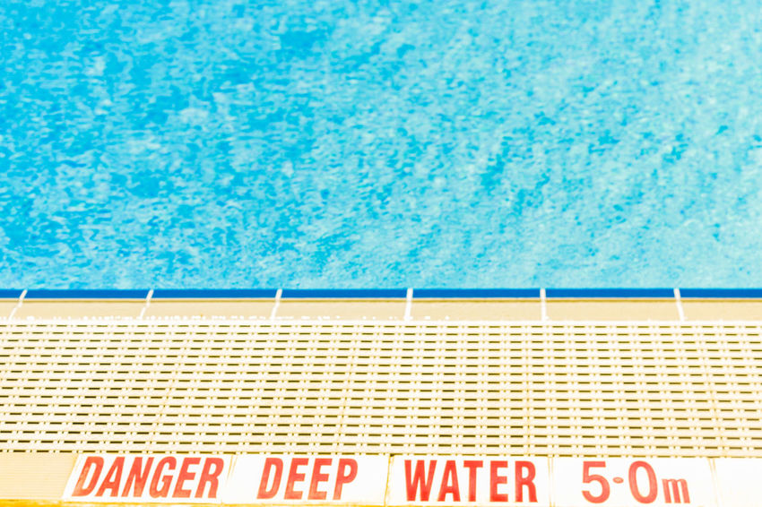 poolside at the Gold Coast Aquatic Centre 2018 Commonwealth Games venue Aquatic Centre At The Edge Of Blue Close-up Communication Day No People Outdoors Poolside Summer Swimming Lane Marker Swimming Pool Text Vacations Water