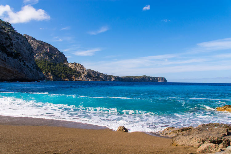 Scene at Coll baix Sea Water Beauty In Nature Beach Land Sky Scenics - Nature Tranquil Scene Tranquility Rock Horizon Over Water Day Rock - Object Nature Blue Cloud - Sky Solid Horizon Idyllic No People Outdoors Turquoise Colored Mallorca Coll Baix