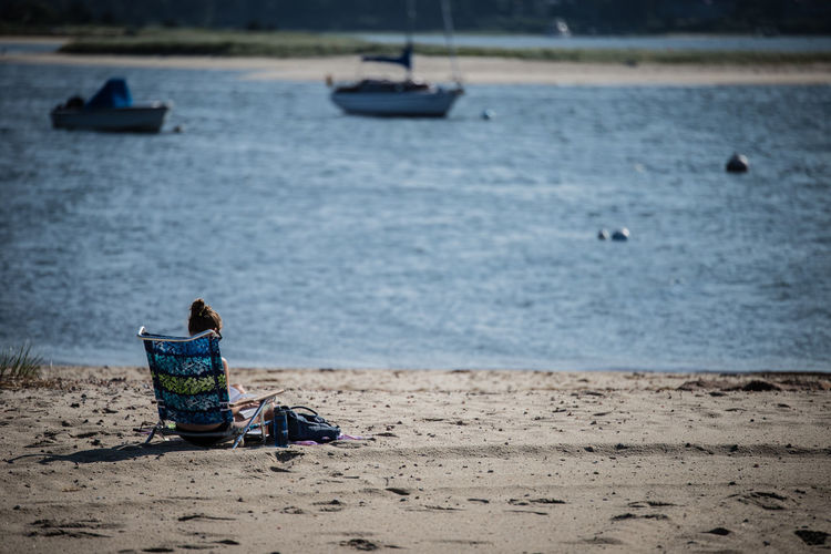 Beach Beauty In Nature Cape Cod Day Massachusetts Nature Nautical Vessel New England  One Person Outdoors Peaceful People Reading Real People Rear View Relaxing Sand Sea Sitting Tranquility Water Sommergefühle