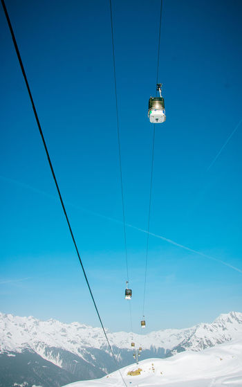 Alpes D'huez Alps France Alps French Alps Mountain Range Mountain Snowcapped Mountain Snow ❄ Snow Covered Snow Winter Cold Temperature Scenics - Nature Nature Beauty In Nature Outdoors White Color Cable Car Sky Overhead Cable Car Blue Cable Ski Lift Hanging Low Angle View Transportation Travel Adventure Connection No People Electricity  Mountain Peak Cable Car The Minimalist - 2019 EyeEm Awards