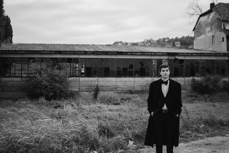 a Young Man posing EyeEm Best Shots Architecture Blackandwhite Building Exterior Built Structure Cloud - Sky Day Field Front View Land Lifestyles Location Looking At Camera Nature One Person Outdoors Portrait Portrait Photography Real People Sky Standing Three Quarter Length Young Adult Young Men