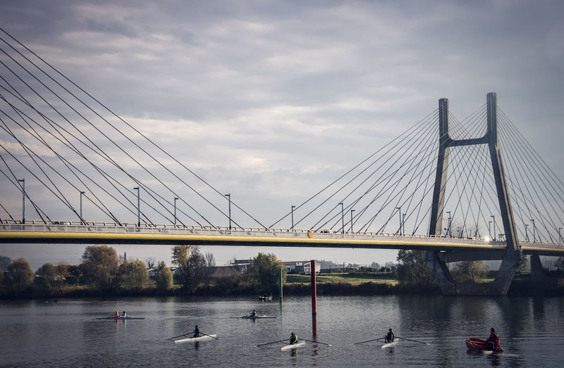 Oar Saone Architecture Bay Bridge Bridge - Man Made Structure Built Structure Cable-stayed Bridge Cloud - Sky Connection Day Engineering Mode Of Transportation Nature Nautical Vessel Outdoors River Rower Sailboat Sky Sport Suspension Bridge Transportation Water Waterfront