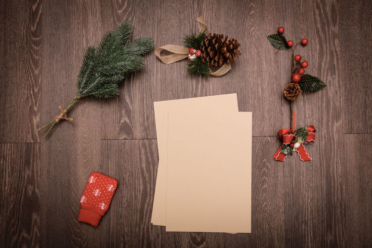 Christmas Backgrounds Branch Christmas Christmas Letter Copy Space Decorations Group Of Objects Herb Indoors  Leaf Nature No People Paper Plank Plant Preparation  Red Rustic Table Tree Winter Wood - Material Writable