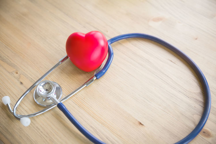 red heart and stethoscope on wood background Care Doctor  Examination Hospital Nurse Background Check Up Concept Health Healthcare And Medicine Heart Shape Love Measurement Medical Equipment Medical Instrument Medical Supplies Red Stethoscope  Table Test Treatment Wood - Material