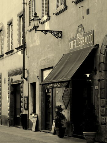 Old wine bar and coffee shop in Volterra Tuscany Architecture No People City Building Exterior Volterra Toscana Tuscany Sepia Vintage Coffee Shop Wine Wine Shop Street Lamp Old Times Classic Romantic Medieval Town Beauty Built Structure
