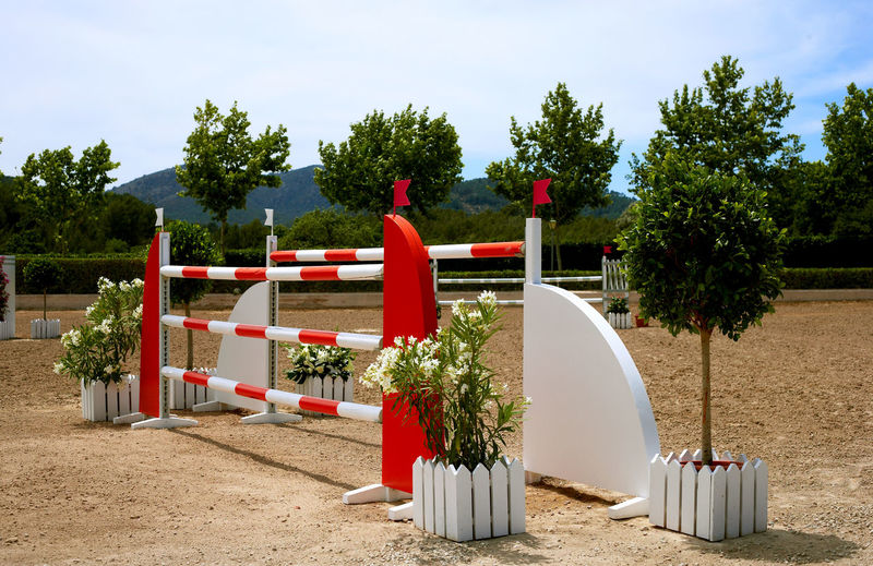 Country Club Jump Architecture Beauty In Nature Beauty In Nature Competition Day Growth Horse Riding At The Beach Horse Riding Barricade Horseridingpark Jumping Nature No People Outdoors Red Red And White Obstacle Sand Sky To Overcome An Obstacle Tree
