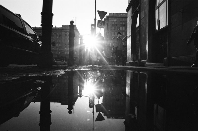 Rollei 400 RPX; Analog in Warsaw The Week on EyeEm Film Photography Analogue Photography Black And White Bnw Monochrome Light And Shadow Capture The Moment Nikonphotography Built Structure Building Exterior Architecture Water Building Reflection Sky City Nature Sunlight Lens Flare No People Sun Sunbeam Residential District Transportation Day Outdoors Canal Bright