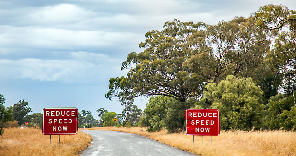 Australia Australian Landscape Outback Road Australia & Travel Beauty In Nature Cloud - Sky Communication Day Guidance Nature No People Outback Australia Outdoors Red Road Road Sign Roadtrip Sky Text Tree Warning Sign Western Script