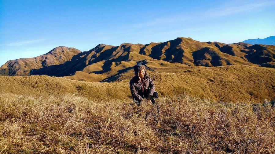 Full length of person on arid landscape against sky