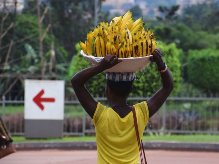 Rear View Of Female Vendor Selling Bananas On Street