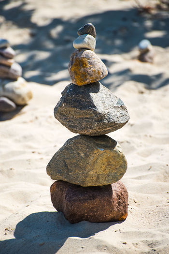 Stack Of Pebbles On Sand At Beach