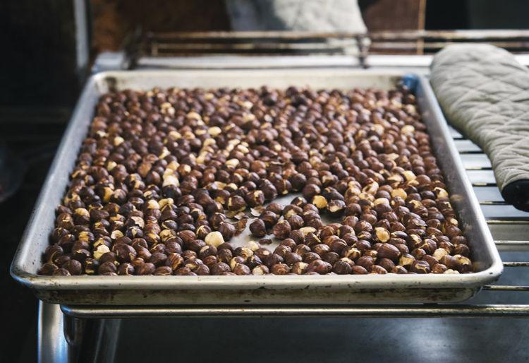 Close-up of hazelnut on tray