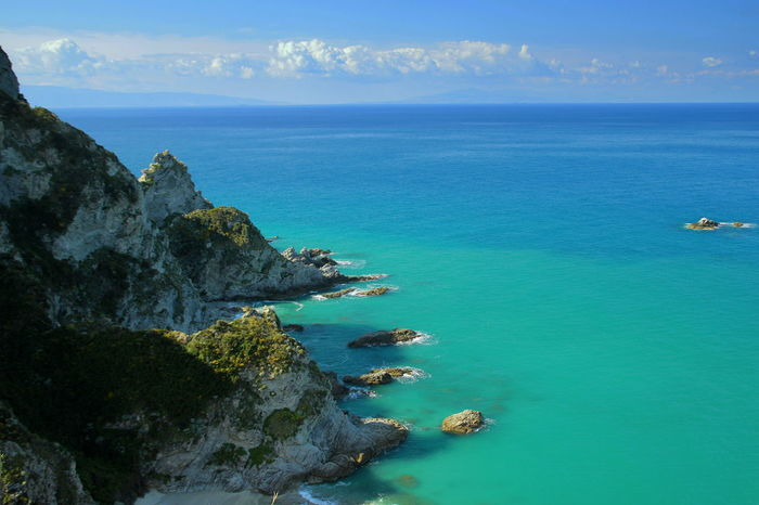 Blue Sea Blue Sky Blue Water Capo Vaticano Cliff Cliffs Coast Day Horizon Over Water Italy Mediterranean  No People Outdoors Rock - Object Rock Formation Rocky Shore Sea Sea Rocks Seashore Seaside Shore Travel Destinations Turquoise Turquoise Water Water