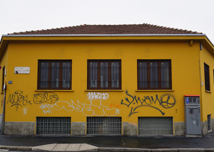 Milano Urban Geometry Architecture Building Building Exterior Built Structure City Communication Day Details Grey Sky Hinterland House No People Outdoors Painting Sony A6000 Tag Text Urban Urban Painting Window Yellow
