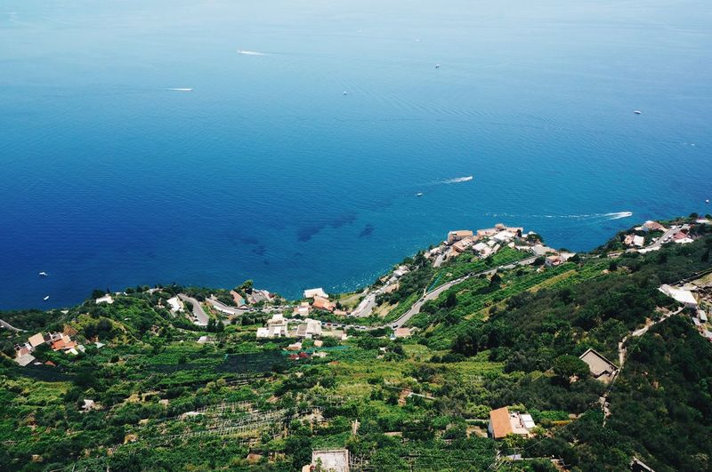 High angle view of town by sea at amalfi coast