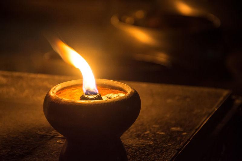 Close-Up Of Diya Burning In Dark