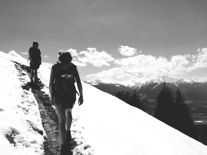 Man And Woman On Top Of Snowcapped Mountain During Sunny Day