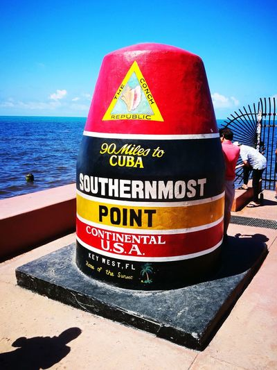southernmost point USA in Key West Huwawie P9 Smart Phone Smartphonephotography Huwaei Photography Sea Beach Politics And Government Water Text Safety Sand Communication Western Script Sky The Mobile Photographer - 2019 EyeEm Awards The Traveler - 2019 EyeEm Awards