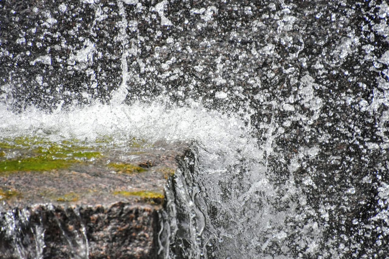 water, motion, splashing, nature, no people, solid, rock - object, rock, sport, sea, day, beauty in nature, blurred motion, outdoors, close-up, wave, aquatic sport, land, scenics - nature, power in nature, flowing water, hitting