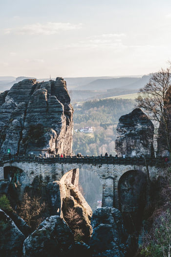 Scenic View Of Tourists On Bastei Bridge